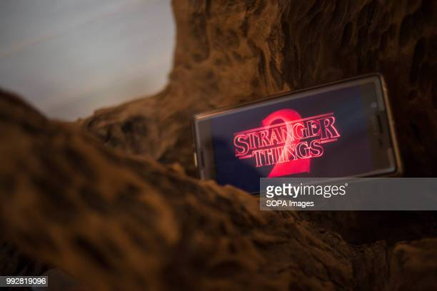 In this photo illustration, the logo 'Stranger Things 2' from the Netflix TV serie seen displayed on a Sony smartphone.