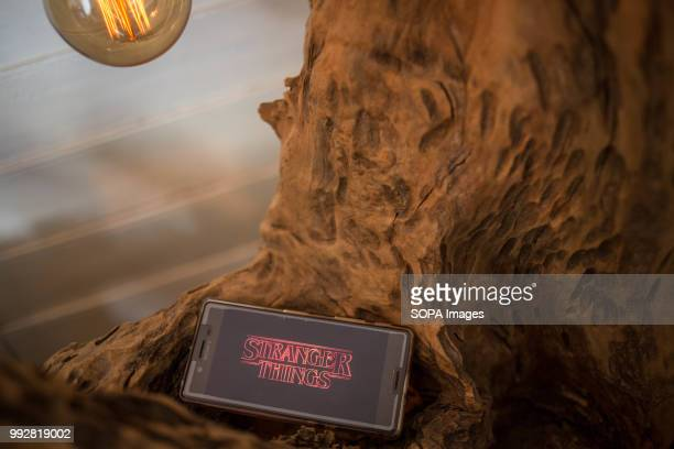 In this photo illustration, the logo 'Stranger Things' from the Netflix TV serie seen displayed on a Sony smartphone.
