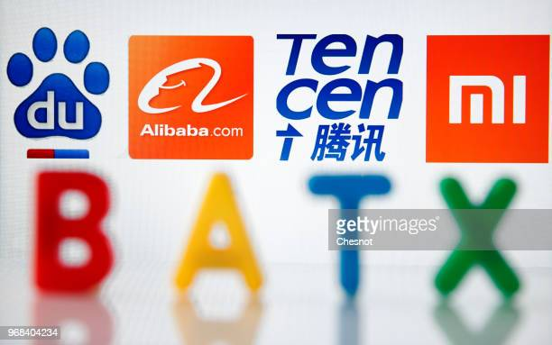 In this photo illustration, the logos of Baidu, Alibaba, Tencent, Xiaomi and the acronym BATX are displayed on a computer screen on June 06, 2018 in...