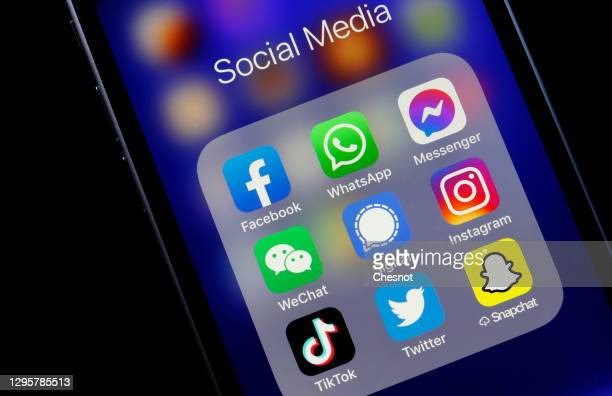 In this photo illustration, the logos of social media applications, Facebook, WhatsApp, Messenger, WeChat, Signal, Instagram, TikTok, Twitter and...