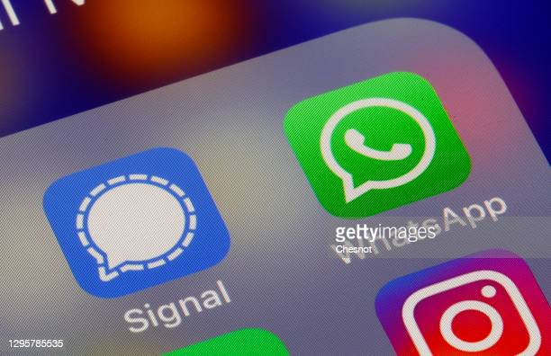 In this photo illustration, the logos of social media applications, Signal and WhatsApp are displayed on the screen of an iPhone on January 11, 2021...