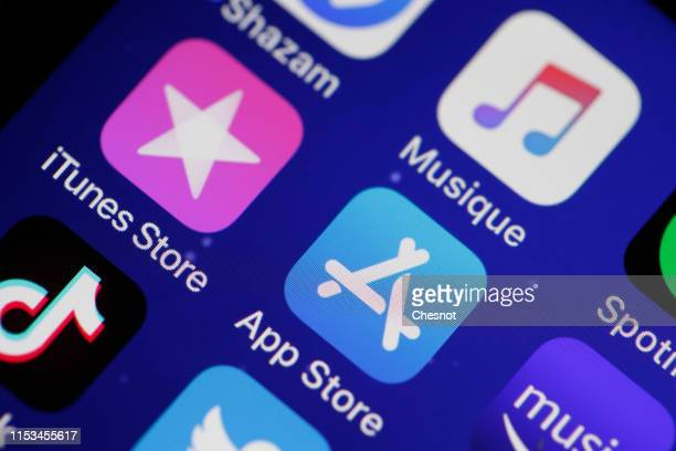 In this photo illustration, the logos of the applications, iTunes Store, App Store and iTunes are displayed on the screen of an iPhone on June 03,...
