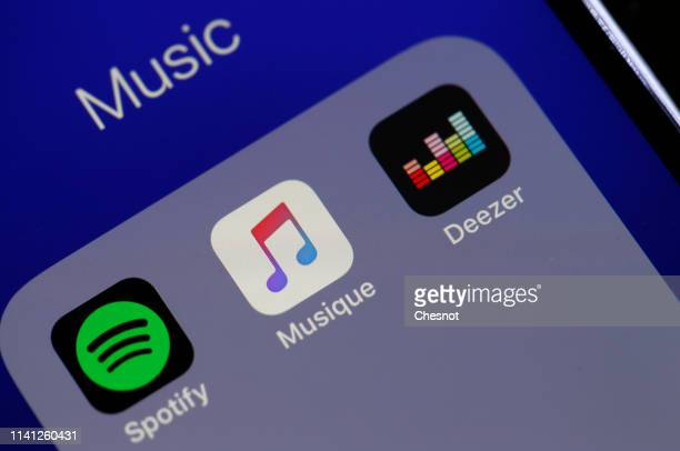 In this photo illustration, the logos of the applications, Spotify, Apple Music and Deezer are displayed on the screen of an iPhone on April 08, 2019...