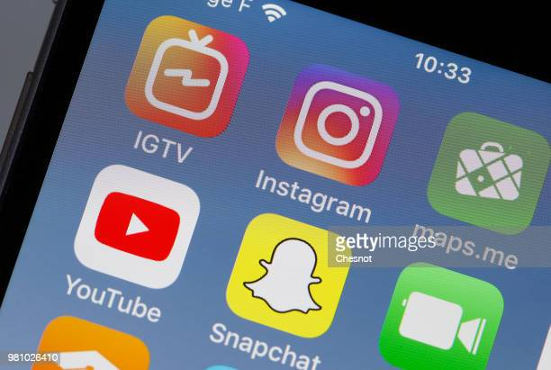 In this photo illustration the logos of the IGTV and Instagram applications are displayed on the screen of an Apple iPhone on June 22 2018 in Paris...