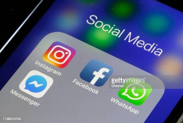 In this photo illustration the logos of the messaging applications WhatsApp Instagram Messenger and Facebook are displayed on the screen of an Apple...