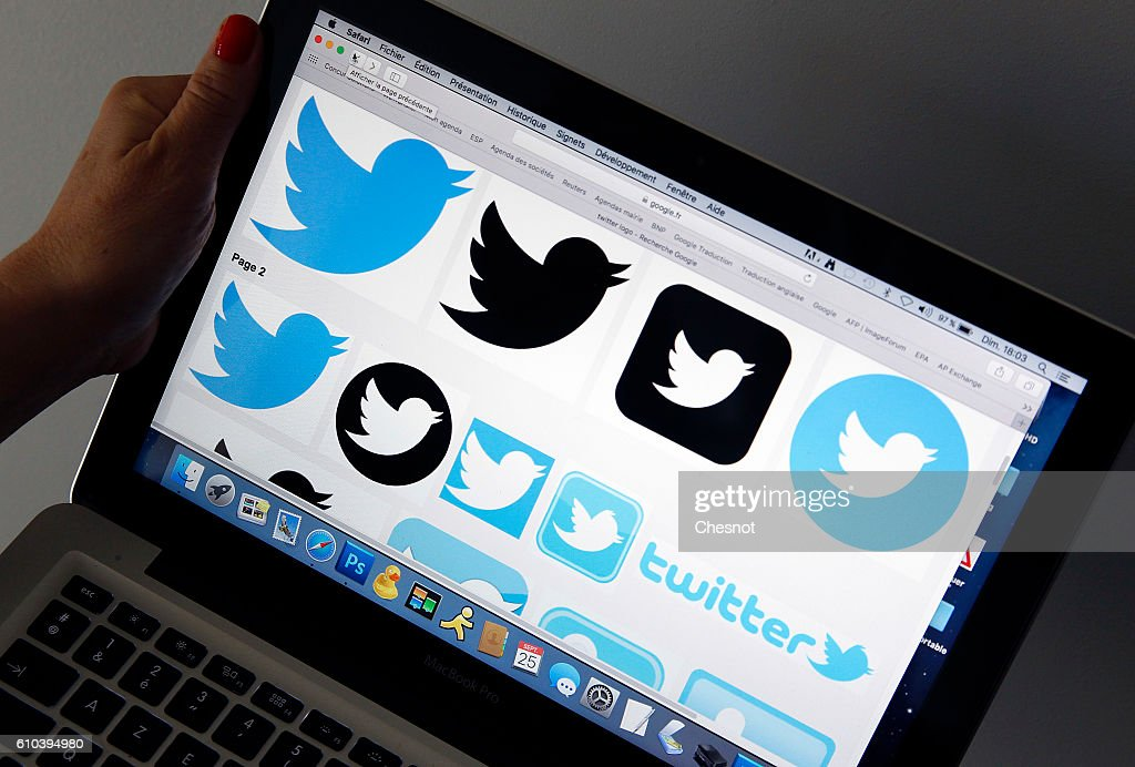 In this photo illustration, The logos of the Twitter social network are displayed on a laptop screen in this arranged photograph on September 25, 2016 Paris, France. According to information from the American television channel CNBC Twitter could be bought by Google (Alphabet) and Salesforce.com group before the end of the year.