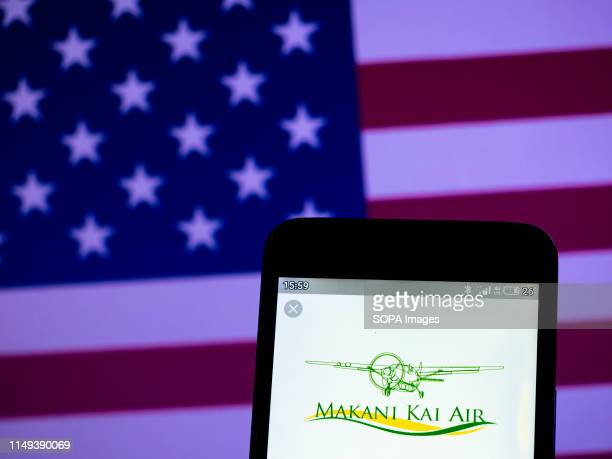 In this photo illustration the Makani Kai Air a subsidiary of Schuman Aviation Company Ltd logo is seen displayed on a smartphone