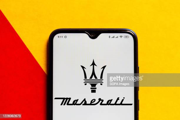 In this photo illustration the Maserati logo seen displayed on a smartphone.