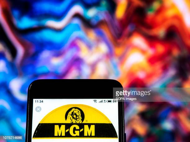 In this photo illustration the MGM Records label logo seen displayed on a smartphone