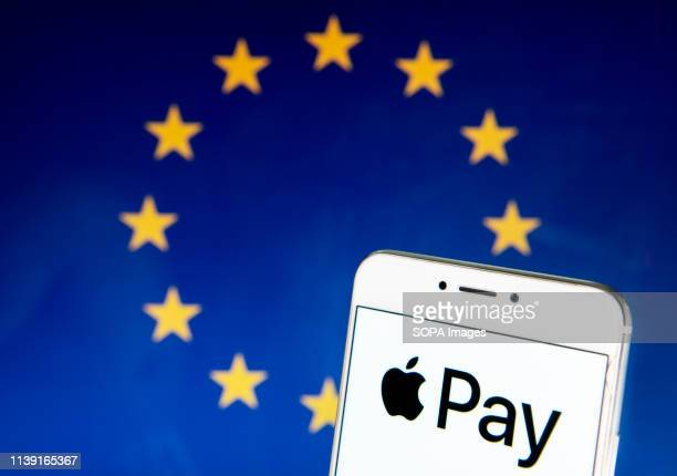In this photo illustration the mobile payment and digital wallet service by Apple Apple Pay logo is seen on an Android mobile device with the...