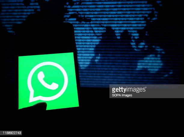 In this photo illustration the most popular messaging application Whatsapp logo seen displayed on a smartphone.
