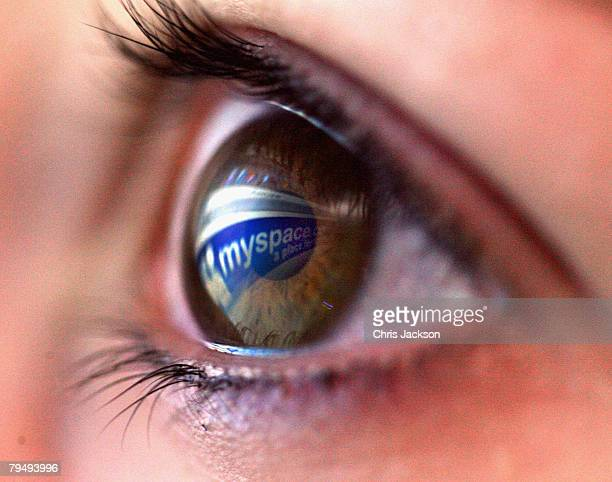 In this photo illustration the myspace logo is reflected in the eye of a girl on February 3 2008 in London England Financial experts continue to...