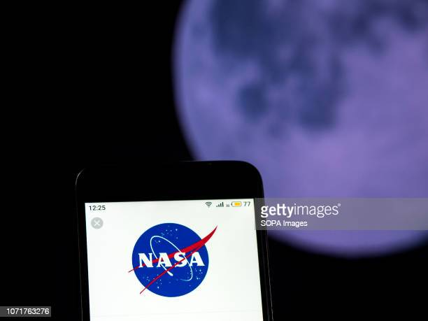 In this photo illustration the Nasa logo seen displayed on a smartphone