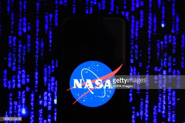 In this photo illustration, the National Aeronautics and Space Administration logo is seen displayed on an Android mobile phone.