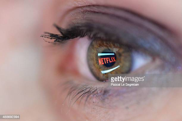 In this photo illustration the Netflix logo is reflected in the eye of a woman on September 19, 2014 in Paris, France. Netflix September 15 launched...