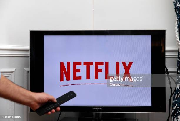 In this photo illustration, the Netflix media service provider's logo is displayed on the screen of a television on February 13, 2019 in Paris,...