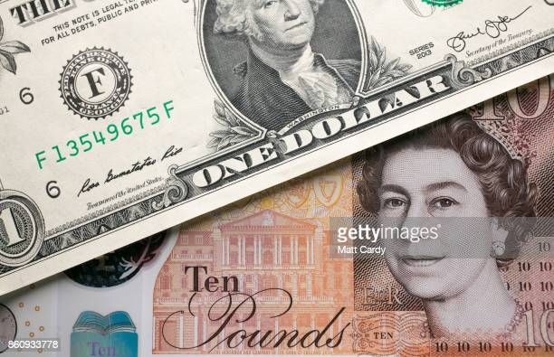 In this photo illustration the new £10 note is seen alongside a US dollar bill on October 13 2017 in Bath England Currency experts have warned that...