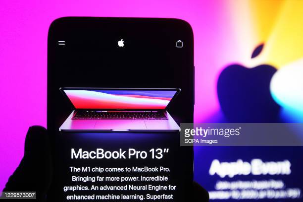 """In this photo illustration the new MacBook Pro 13"""" computer seen on a mobile phone screen. Apple presented their new products of MacBook series..."""