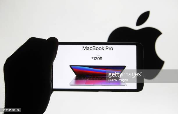 In this photo illustration the new MacBook Pro seen on a mobile phone screen. Apple presented their new products of MacBook series computers during...