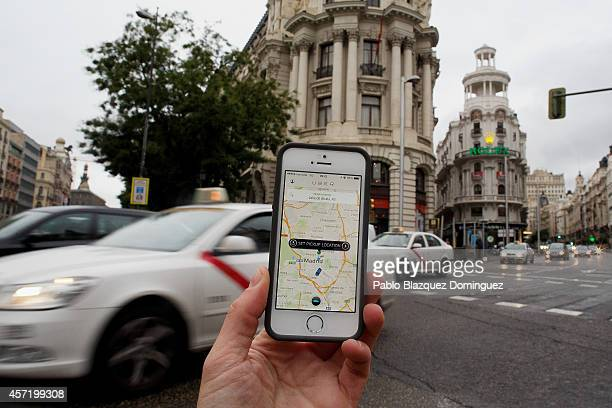 In this photo illustration the new smart phone taxi app 'Uber' shows how to select a pick up location at Alcala Street on October 14 2014 in Madrid...