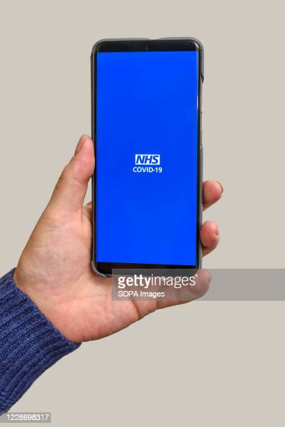 In this photo illustration the NHS Test and Trace app which has been launched in England and Wales is displayed on a smartphone. People have been...