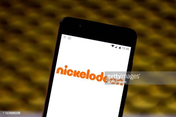 In this photo illustration the Nickelodeon logo is seen displayed on a smartphone.
