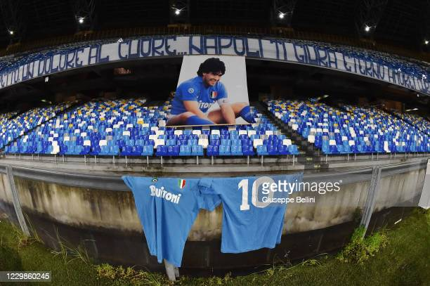 In this photo illustration, the official shirt of Argentine football legend Diego Armando Maradona is photographed in front of a banner of the former...