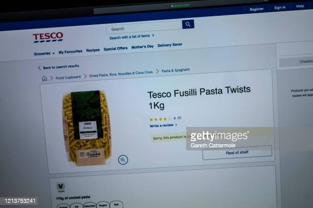 In this photo illustration the online retailer Tesco advises customers of its current grocery stock levels on March 19 2020 in Essex England Many...