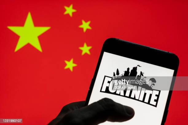 In this photo illustration the online video game by Epic Games company Fortnite logo seen on an Android mobile device with People's Republic of China...