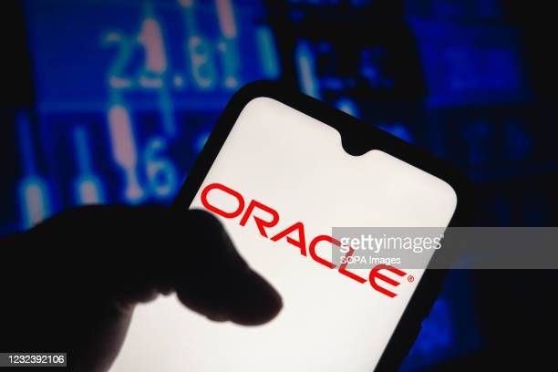In this photo illustration the Oracle Corporation logo seen displayed on a smartphone screen.