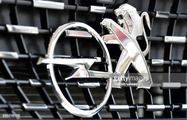 In this photo illustration the Peugeot hood ornament and the Opel hood ornament is seen on February 15 2017 in Darmstadt Germany PSA Peugeot Citroen...