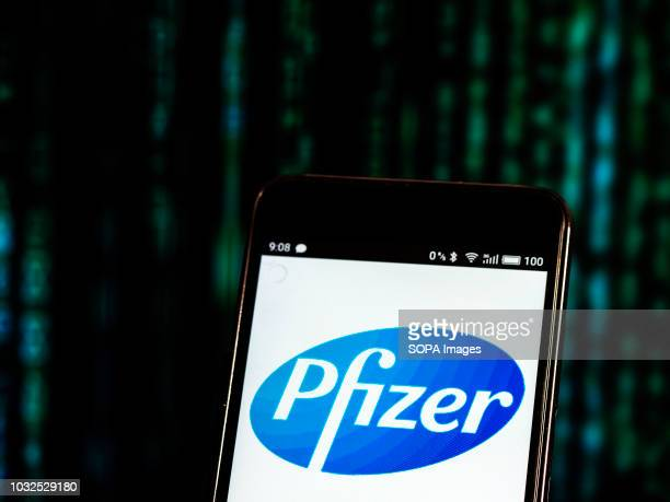 In this photo illustration the Pfizer logo seen displayed on smart a smartphone
