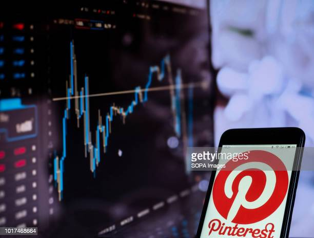 In this photo illustration the Pinterest social networking website seen displayed on a smartphone