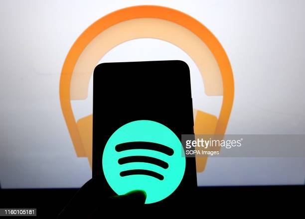 In this photo illustration the popular audio streaming social media application Spotify logo seen displayed on a smartphone.