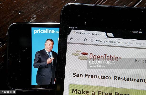 In this photo illustration the Priceline and OpenTable websites are displayed on mobile devices on June 13 2014 in San Anselmo California Online...