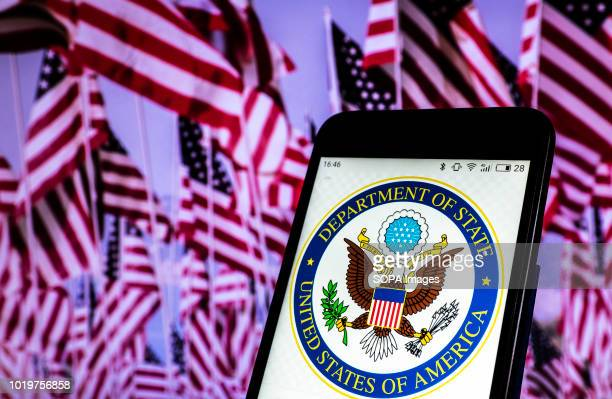 In this photo illustration the Seal of United States Department of State seen displayed on a smartphone