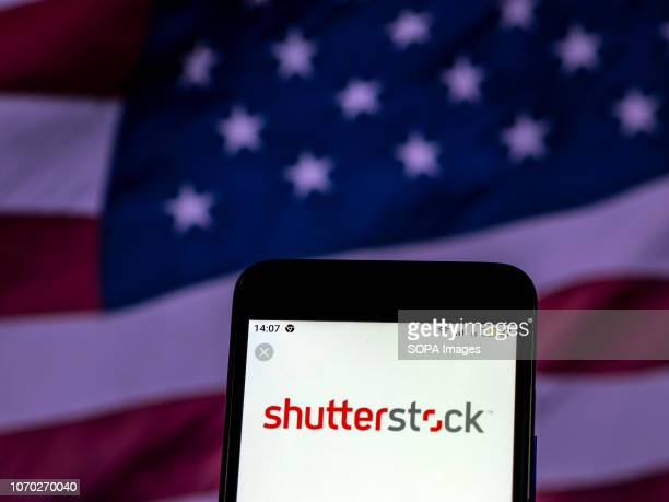 In this photo illustration the Shutterstock Stock photography company logo seen displayed on a smartphone
