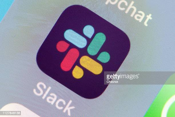 In this photo illustration, the Slack application logo is displayed on the screen of an Apple iPhone on February 06, 2019 in Paris, France. Slack...