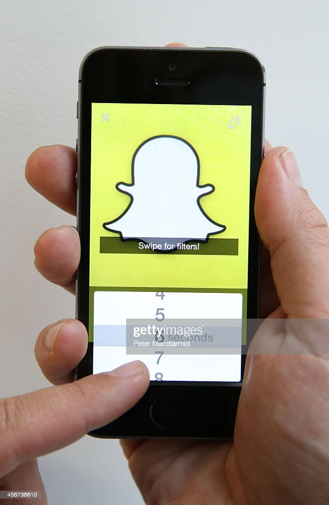 In this photo illustration the Snapchat app is used on an iPhone on October 6, 2014 in London, England. Snapchat allows users' messages to vanish after seconds. It is being reported that Yahoo may invest millions of dollars in the start up firm.