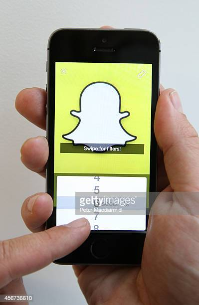 In this photo illustration the Snapchat app is used on an iPhone on October 6 2014 in London England Snapchat allows users' messages to vanish after...