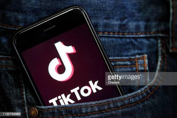 In this photo illustration the social media application logo Tik Tok is displayed on the screen of an iPhone on March 05 2019 in Paris France The...
