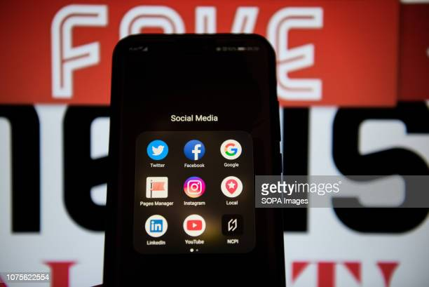 Social media logos are seen on an android mobile phone