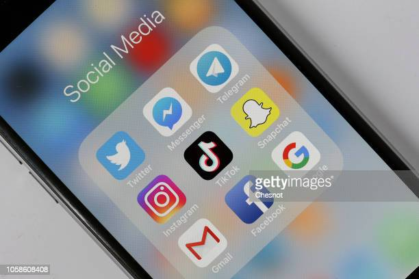 In this photo illustration the social medias applications logos Twitter Messenger Telegram Instagram Tik Tok Snapchat Gmail Facebook and Google are...