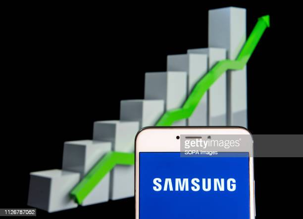 In this photo illustration the South Korean multinational electronics conglomerate Samsung logo is seen displayed on an Android mobile device with an...