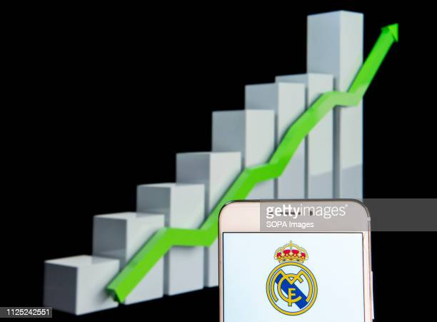 In this photo illustration the Spanish professional football club team Real Madrid Club de Fútbol commonly known as Real Madrid logo is seen...