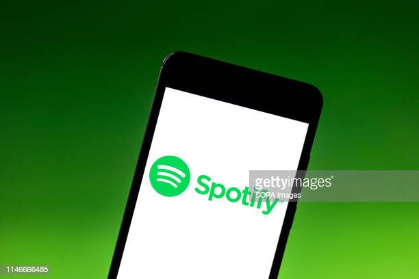 In this photo illustration the Spotify logo is seen displayed on a smartphone