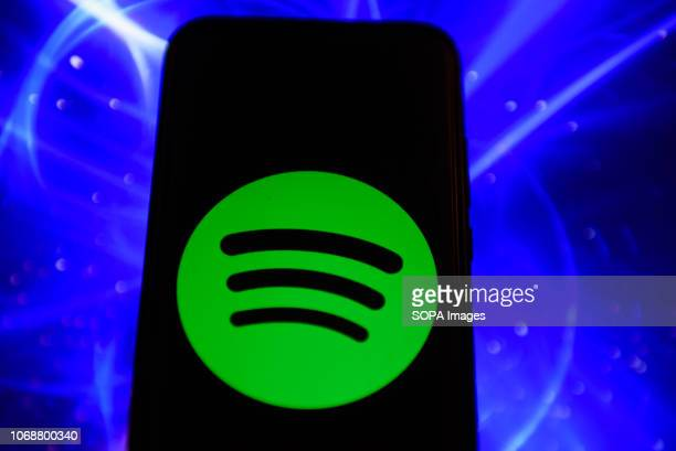 In this photo illustration the Spotify logo is seen displayed on an Android mobile phone