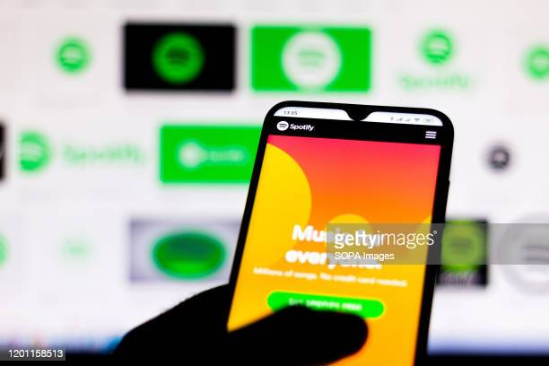 In this photo illustration the Spotify website seen displayed on a smartphone.
