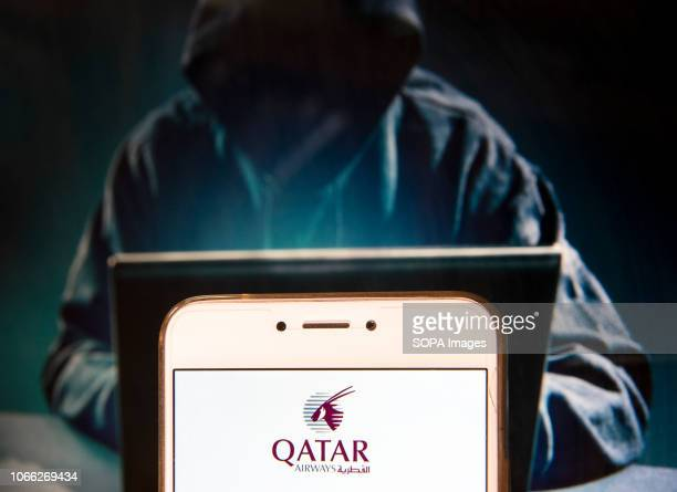 In this photo illustration the Stateowned flag carrier of Qatar Qatar Airways logo is seen displayed on an Android mobile device with a figure of...