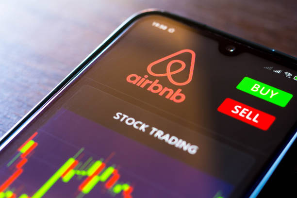 in this photo illustration the stock trading graph of airbnb seen on picture